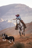 Cowgirl at Full Gallop with Cowdogs Leading Way Photographic Print by Terry Eggers