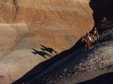 Riders with Shadow Coming down Hill in Painted Desert Photographic Print by Terry Eggers