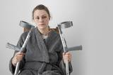 Woman Seated with Crutches Photographic Print by Anthony West