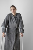 Woman on Crutches Photographic Print by Anthony West