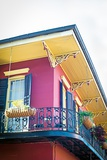 Corner of Red Home with Balcony in French Quarter of New Orleans Photographic Print by  Allen G