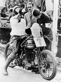 Van Horne Taking a Drink Whilst on His Norton Bike Photographic Print