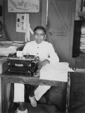 A Young Man Sitting at a Typewriter, Indonesia, 20th Century Photographic Print