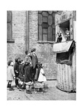 Children Watching a Punch and Judy Show in a London Street, 1936 Giclee Print by Donald Mcleish