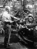 Man Operating Machinery in a Car Factory Photographic Print