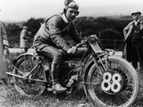 A Man Dressed in Leathers on a Harley-Davidson Reprodukcja zdjęcia