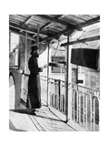 Monk Sounding the Call to Prayer on a Gong, Greece, 1936 Giclee Print by  Nomias
