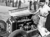 Attilio Marinoni, Chief Mechanic of Scuderia Ferrari, with an Alfa Romeo, 1934 Photographic Print