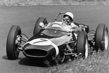 Stirling Moss Taking a Bend in a Racing Car, (C1960-C1961) Photographic Print