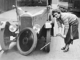 Ivy Cummings Changing a Tyre on a 1925 Singer 10/26, London, C1925 Photographic Print
