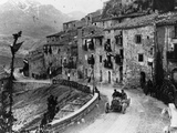 Felice Nazzaro Driving Through Pettralia Sottana in a Fiat, in the Targa Florio Race, Sicily, 1907 Photographic Print