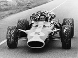 Jim Clark in a Lotus with the Winner's Laurel Wreath Photographic Print