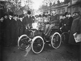 Louis Renault in the Driver's Seat of a Voiturette Renault 1¾ Hp, 1899 Photographic Print