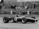 Jim Clark Driving the Lotus 49 at the British Grand Prix, Silverstone, 1967 Fotografisk tryk