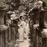 A Woman Shinto Devotee Counting the Stone Lanterns, Kasuga Shrine, Nara, Japan, 1904 Photographic Print