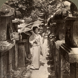 A Woman Shinto Devotee Counting the Stone Lanterns, Kasuga Shrine, Nara, Japan, 1904 Photographic Print by  Underwood & Underwood