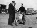 Stirling Moss on a Vespa Scooter, Goodwood, April 1952 Photographic Print