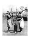 Two Mashona Tribeswomen Pounding Maize and Millet, Zimbabwe, Africa, 1936 Giclee Print