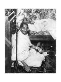 Mohondas Karamchand Gandhi (1869-194), Working at His Spinning Wheel Giclee Print
