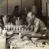 A Potter and His Wheel, Fashioning a Vase of Awata Porcelain, Kinkosan Works, Kyoto, Japan, 1904 Photographic Print by  Underwood & Underwood
