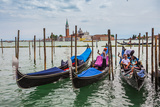 Gondolas Moored by Saint Mark Square Photographic Print by Oleg Zhukov