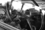 Old Chevrolet Truck's Steering Wheel in Black and White Photo