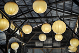 Paper Lanterns Hanging in a Barn in Charleston, SC Photo