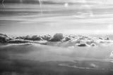Cloud Formation from Out a Plane Window in Black and White Photo