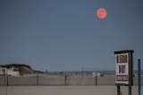 Super Moon and Lifeguard Sign Seen on Atlantic Beach on Long Island, NY Photo