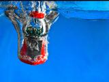 Gumball Machine Dropping into Water Reprodukcja zdjęcia autor EvanTravels