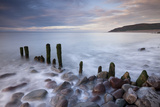 Wooden Groyne on Porlock Beach, Exmoor, Somerset, England. Summer Photographic Print by Adam Burton