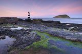 Dusk over Penmon Point Lighthouse and Puffin Island, Isle of Anglesey, Wales, UK. Spring Photographic Print by Adam Burton