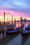 Italy, Venice. Gondolas Moored on Riva Degli Schiavoni at Sunrise Fotografisk tryk af Matteo Colombo