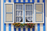 Window of a Traditional Striped Painted House in the Little Seaside Village of Costa Nova, Portugal Photographic Print by Mauricio Abreu