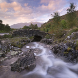 Ashness Bridge in the Lake District National Park, Cumbria, England. Autumn (September) Photographic Print by Adam Burton
