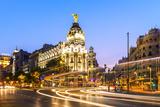 Spain, Madrid. Cityscape at Dusk with Famous Metropolis Building Reproduction photographique par Matteo Colombo