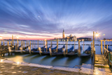 Italy, Veneto, Venice. Row of Gondolas Moored at Sunrise on Riva Degli Schiavoni Photographic Print by Matteo Colombo
