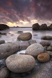 Sunset over the Atlantic from the Shores of Porth Nanven, Cornwall, England. Autumn Photographic Print by Adam Burton