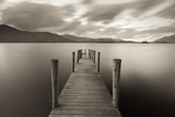 Wooden Jetty on Derwent Water in the Lake District, Cumbria, England. Autumn Photographic Print by Adam Burton