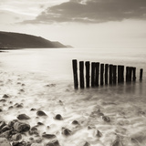 Wooden Groynes on Bossington Beach at Sunset, Exmoor National Park, Somerset, England. Spring Photographic Print by Adam Burton