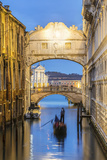 Italy, Veneto, Venice. Bridge of Sighs Illuminated at Dusk with Gondolas Photographic Print by Matteo Colombo
