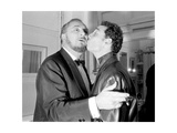 Pierre and Claude Brasseur Kissing Photographic Print by Marcel Begoin