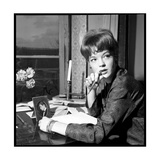 Romy Schneider, Thougthful, Trying to Write a Letter in Front of Alain Delon's Picture Photographic Print by Marcel Begoin