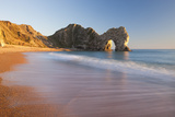 Waves Sweeping onto the Deserted Beach at Durdle Door, Dorset, England. Winter Photographic Print by Adam Burton