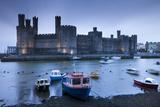 Foreboding Evening Skies Above the Immense Caernarfon Castle, Caernarfon, Gwynedd Photographic Print by Adam Burton
