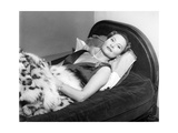Michèle Morgan Laid on a Bed, 1951 Photographic Print by Marcel Begoin