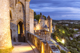 France, Languedoc-Roussillon, Aude, Carcassonne. Walls and Towers of the Old Town at Dusk Photographic Print by Matteo Colombo