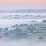 Farmhouse and Mist Covered Countryside, Stockleigh Pomeroy, Devon, England. Autumn (September) Photographic Print by Adam Burton