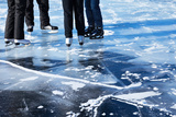 Ice Skating on the Frozen Lake Baikal Photographic Print by  katvic