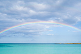 Rainbow over Ocean Photographic Print by  bradcalkins